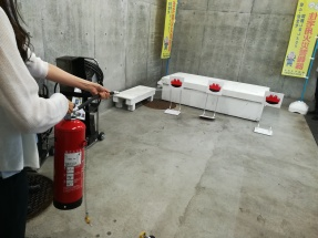 Practicing how to use a fire extinguisher