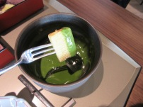 Dipping cake into the matcha goodness